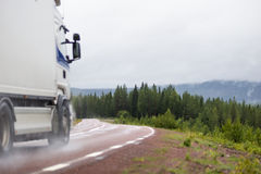 Truck on wet road Royalty Free Stock Image