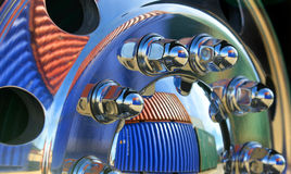 Truck wheel with containers. Shipping containers reflected in prime mover wheel hub Stock Image