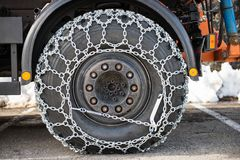Truck wheel with snow chains Royalty Free Stock Photography