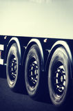 Truck wheels closeup in motion Royalty Free Stock Images