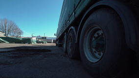 The truck wheels. The wheels of huge truck parked at the warehouse. Horizontal outdoors shot stock video footage