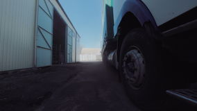 The truck wheels. The wheels of huge truck parked at the warehouse. Horizontal outdoors shot stock video