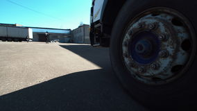 The truck wheels. The wheels of huge truck parked at the warehouse. Horizontal outdoors shot stock footage