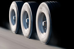 Truck wheels in motion. Close-up on spinning truck wheels in motion Stock Photos