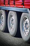 Truck wheels in motion. Close-up on spinning truck wheels in motion royalty free stock photography