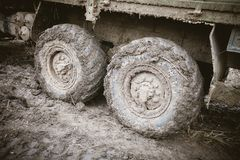Truck wheels in the mud. Off-road travel concept. Off-road truck royalty free stock photography