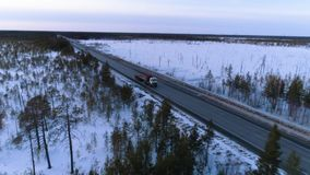 Truck on the winter road. Flight over the winter road stock video footage
