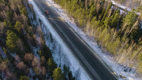 Truck on the winter road. Flight over the winter road stock video