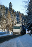 Truck on a winter road Royalty Free Stock Photography