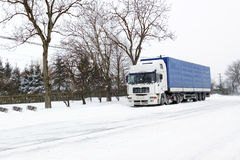 Truck on winter road. White truck on winter road Royalty Free Stock Images