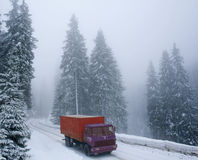 Truck on a winter snowy road. Red truck on winter snowy road Stock Photography