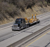 Truck With Heavy Equipment Parts Royalty Free Stock Image