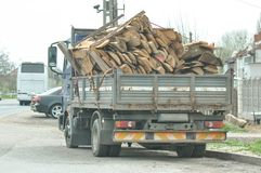 Truck with wooden boards. Near a highway Stock Photos