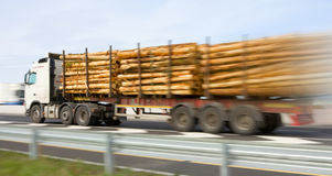 Truck with wooden logs in motion, blurred Stock Photos
