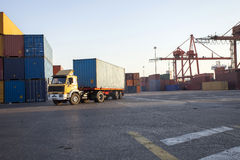 Truck working in port carrying containers Stock Photography