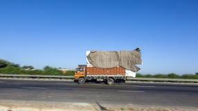 Truck on the Yamuna Expressway. JEWAR BANGER, INDIA - NOV 12, 2011: Truck on the Yamuna Express Highway in Uttar Pradesh Royalty Free Stock Photo