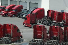 Truck Yard. Red Trucks in Shipping Company Truck Yard, California Stock Images