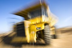 Truck zooming. Mining truck zooming at worksite Royalty Free Stock Photography