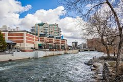 Truckee river flowing through downtown Reno, Nevada. Reno, Nevada skyline as seen from the shoreline of Truckee river flowing through downtown stock photo