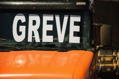Trucker on strike. Orange truck with the windshield written Grev. E in portuguese Royalty Free Stock Photo