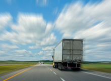 Trucking. Truck drives down road with motion blur Stock Images