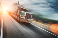 Trucking. American truck speeding freeway Royalty Free Stock Images