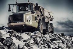 Trucking in extreme terrain. Large pick-up truck driving through extreme terrain of snow, ice and rocks royalty free stock photo