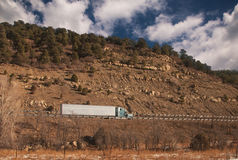 Trucking On Freeway. Trucking On mountain Freeway western u,s Royalty Free Stock Images