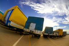 Trucking industry. Industry and commerce: trucks parked in a harbor Royalty Free Stock Photography