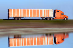 Trucking Magic. Panned Motion Blur of Eighteen Wheel Truck Reflected in Pond Stock Images