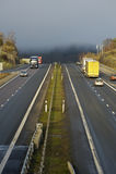 Trucking through misty mountain-pass Stock Image