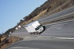 Trucking on scenic freeway Stock Image