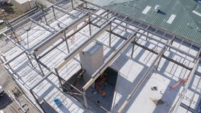 Trucking shot of an urban construction site. Aerial view of a commercial building being constructed stock footage