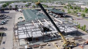Trucking shot of an urban construction site. Aerial view of a commercial building being constructed stock video