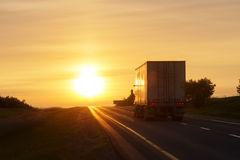 Trucking at sunrise on an empty road Stock Photography