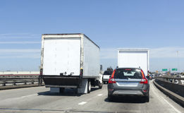 Trucking Traffic. Freight, cargo and delivery vehicles in heavy urban traffic Stock Image