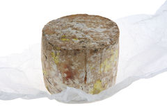 Truckle of Gourmet Cheese. A truckle of organic West Country goat's cheese, handmade from pasturised milk, on grease-poof paper wrapping Stock Image