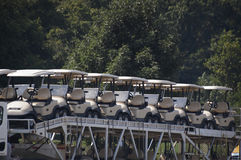 A truckload of golf carts. Golf carts that go on and on Stock Image