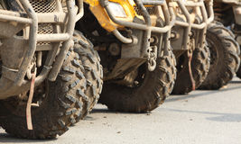 Trucks. Low angle view of the front part of a row of ATVs Stock Image