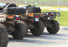 Trucks. Low angle veiw of  a row of dirty ATVs Royalty Free Stock Images