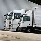 Trucks. Three white trucks are waiting in a row Royalty Free Stock Image