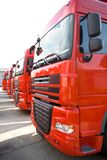 Trucks. Red Trucks stand in line Royalty Free Stock Image