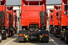 Trucks. Red Trucks stand in line Royalty Free Stock Images