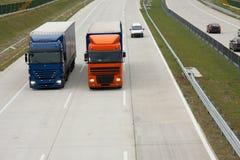 Trucks. Running on the highway Stock Photos