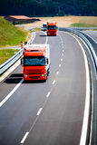 Trucks. Two trucks on the road Royalty Free Stock Photos
