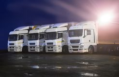 Free Trucks At Night In Parking Lot Royalty Free Stock Photos - 99676078