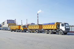 Trucks on the background of a chemical plant in Gomel, Belarus. GOMEL, BELARUS - AUGUST 22: After reconstruction, the Gomel chemical phosphoric acid will produce Royalty Free Stock Photos