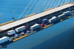Trucks on a bridge Royalty Free Stock Images