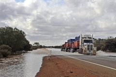 Only Trucks can get Through, as the River is Rising. royalty free stock photos