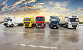 Trucks - Cargo Transport, Transportation. At sunset Stock Image